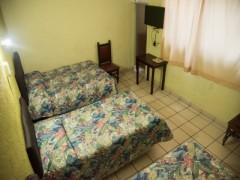 Foto de la habitacion Estándar 2 Camas Matrimoniales y 1 Cama Individual
