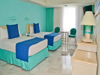 hotel_park_royal_cancun_2_camasPjUj7wsGLJhHxV70